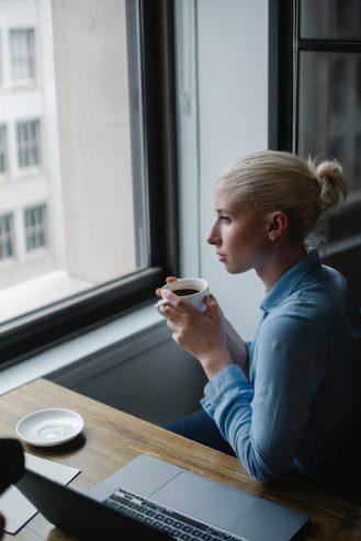 woman drinking coffee in modern office