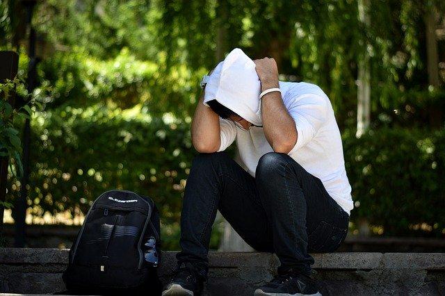 upset man wearing a white hoodie