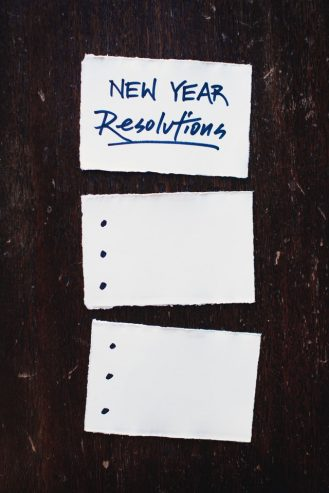 three pieces of paper on a table with new year resolutions on one page