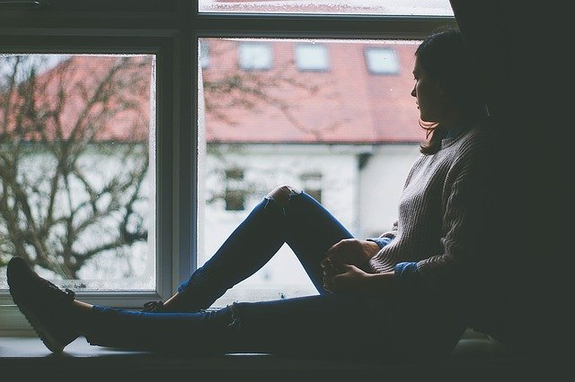 woman sitting near the window
