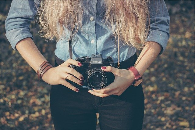 woman taking picture using a camera
