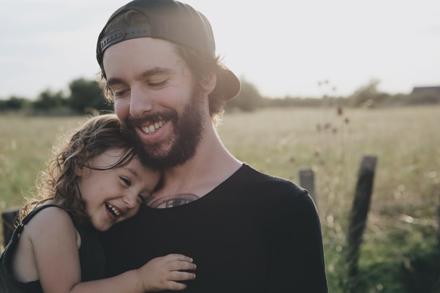 dad smiling with her daughter