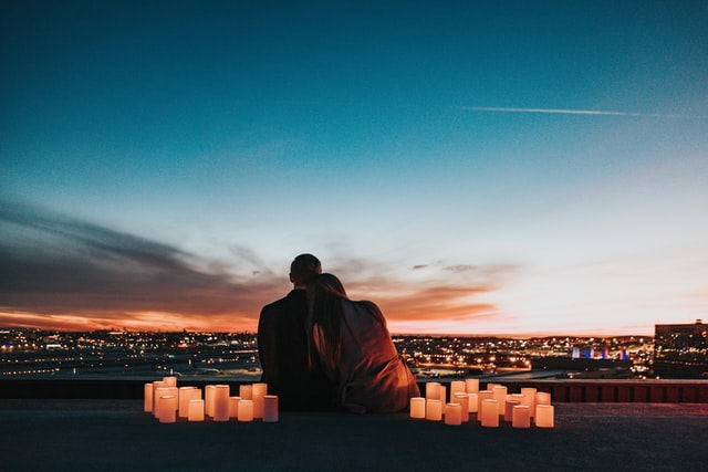 couple sitting while overlooking the city