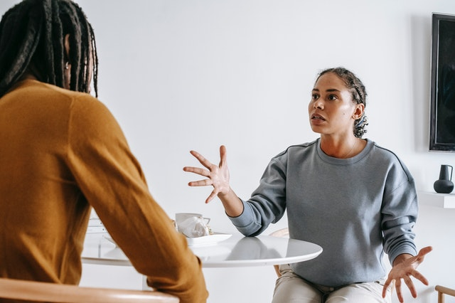 African American couple arguing at table