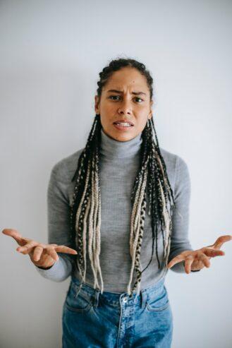 irritated black woman gesturing and talking emotionally
