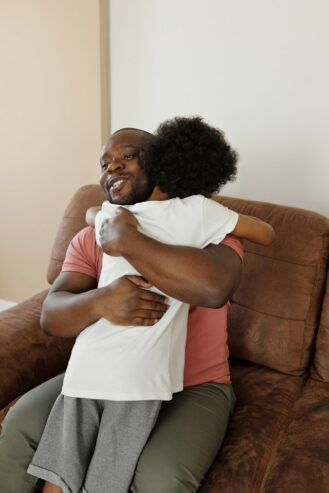 father and son hugging