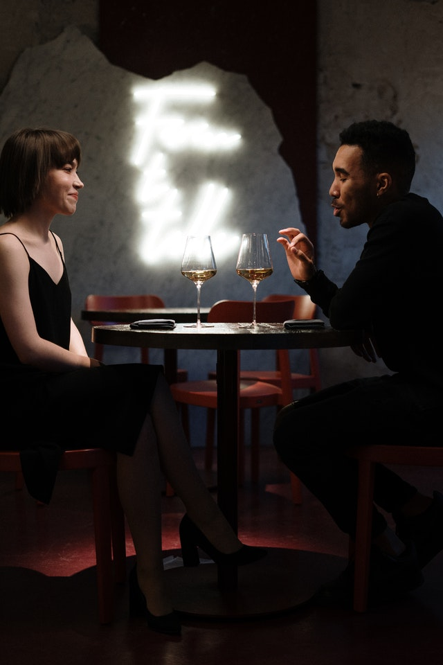 man and woman having a dinner date
