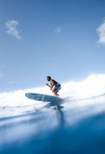 man surfing on blue sea water