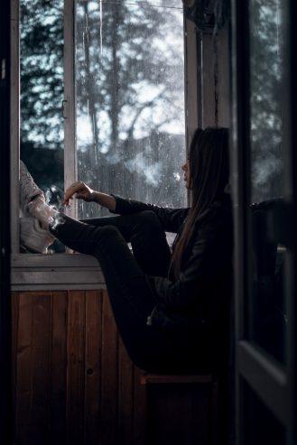 women sitting near window
