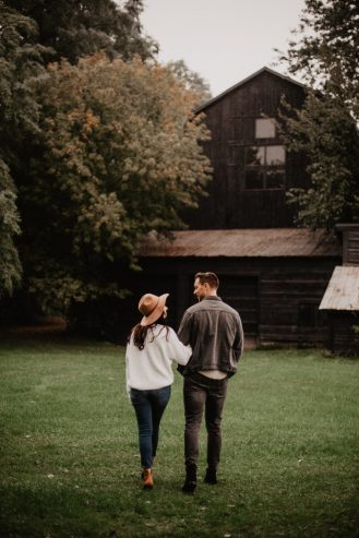 couple standing on green grass