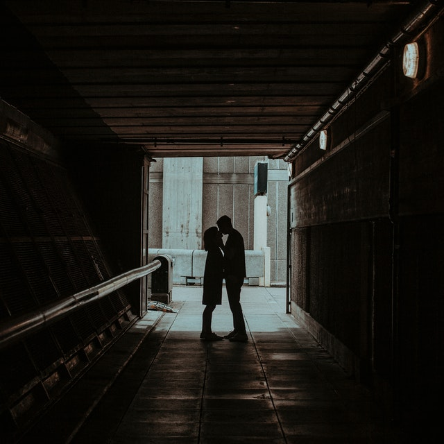 couple kissing in a hallway
