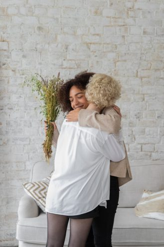 multiracial women hugging each other