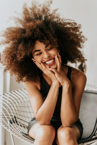 curly woman smiling