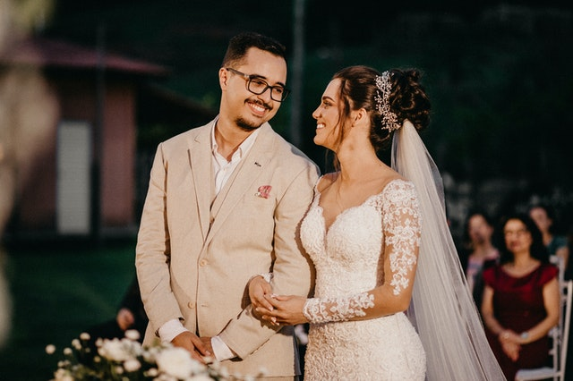 photo of a groom and a bride