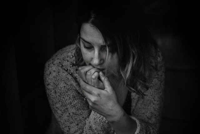 woman biting her fingers