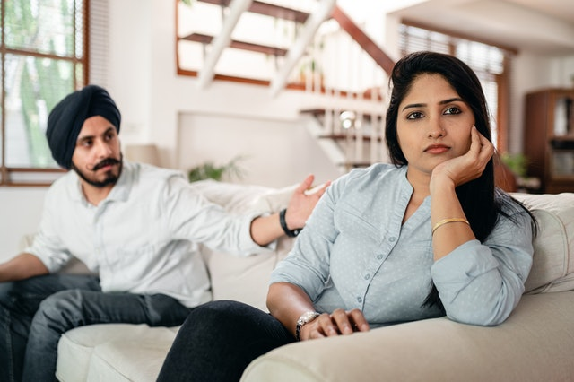 young Indian couple having argument at home