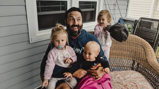 happy man with children on terrace