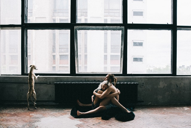 couple sitting and hugging on the floor