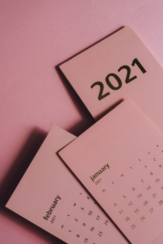 paper calendars with months on pink background