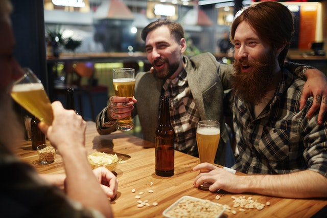friends drinking at the bar