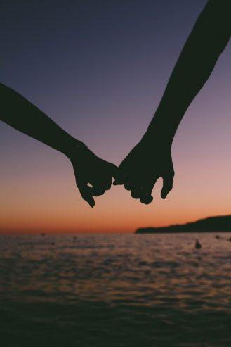 couple holding pinkies
