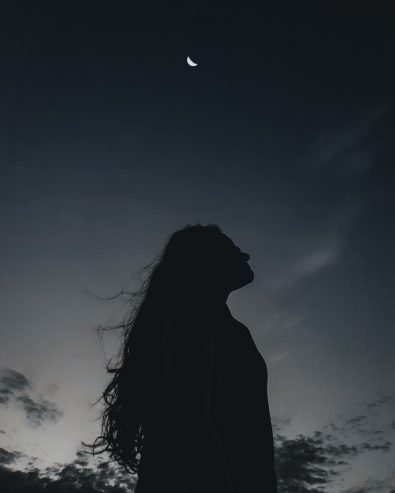 lonely woman under night sky
