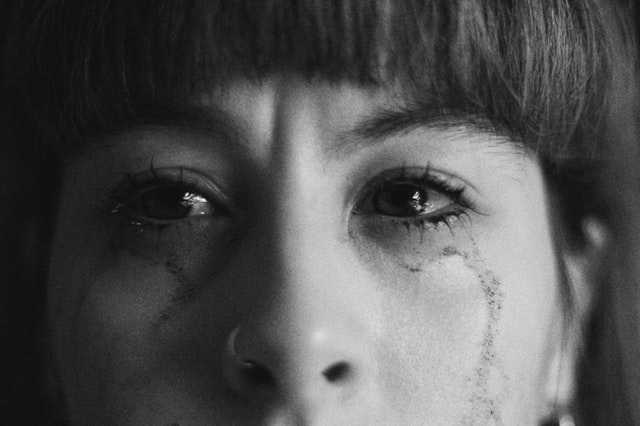 crop crying woman with smearing makeup