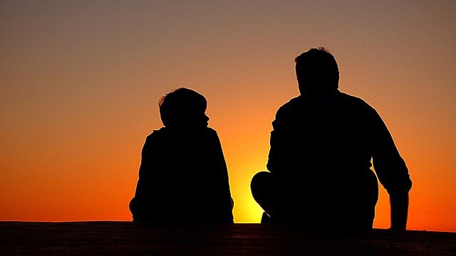 silhouette of father and son during sundown