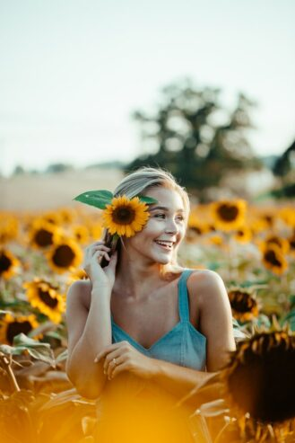 woman with sunflower on her ear