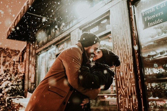 couple hugging on the snow