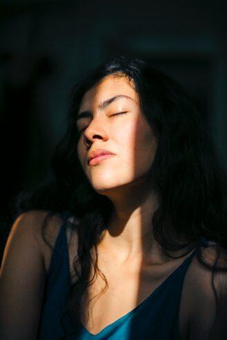 woman closing her eyes