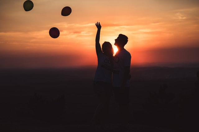 silhouette photo of a couple standing outdoors