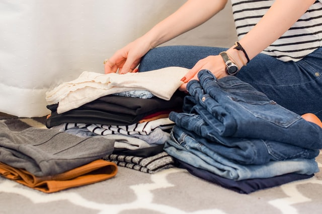woman arranging her clothes