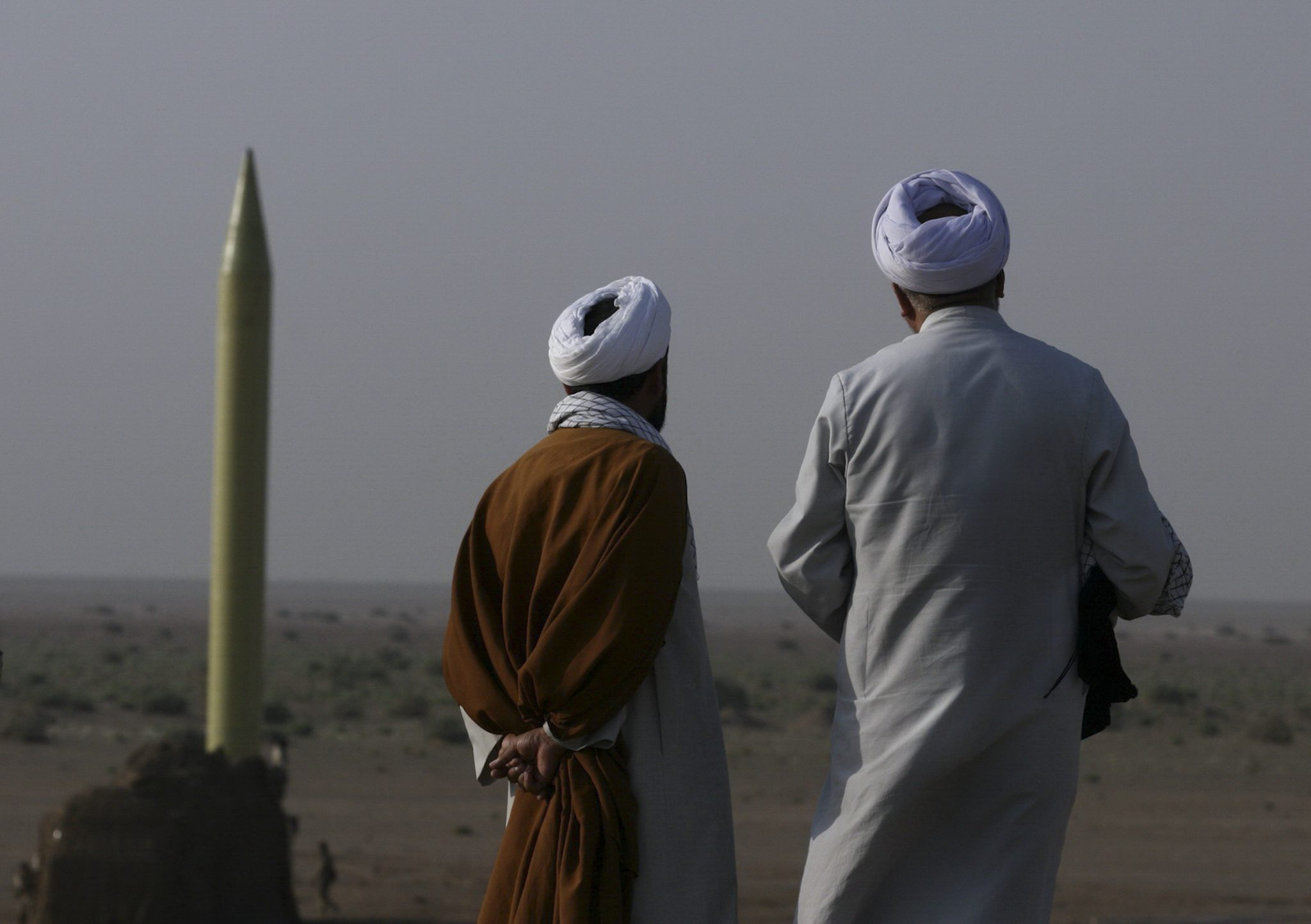 Iranian clerics stand near surface to surface missile which is ...