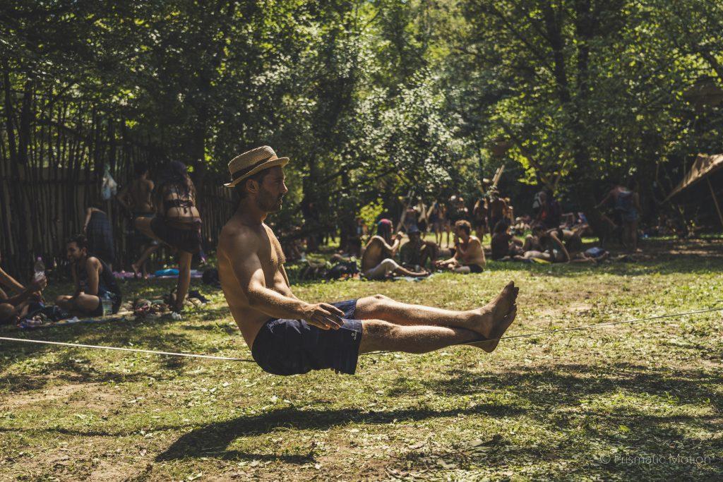 Man sitting on slackline at Modem festival