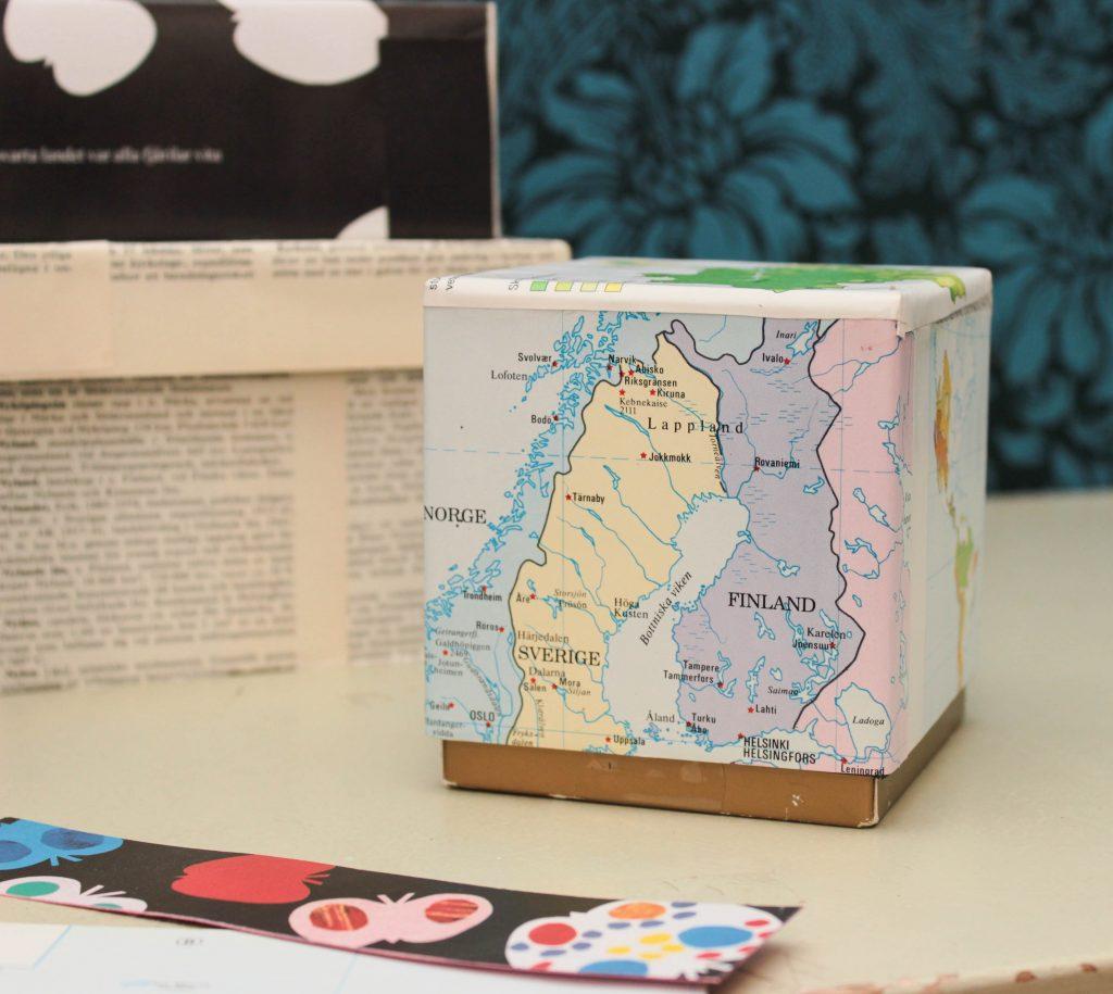 Telåda som täckts med karta över Sverige, Norge och Finland.