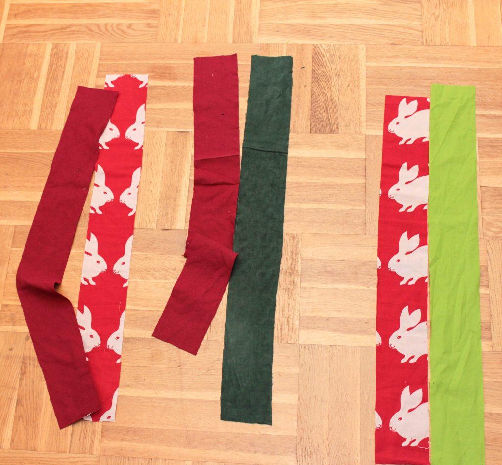 Remsor tyg i rött och grönt.