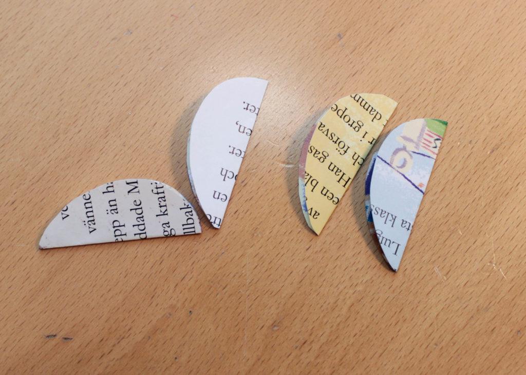 Hur du viker äggen på mitten så att sidan du vill ha utåt hamnar inåt och texten hamnar utåt.