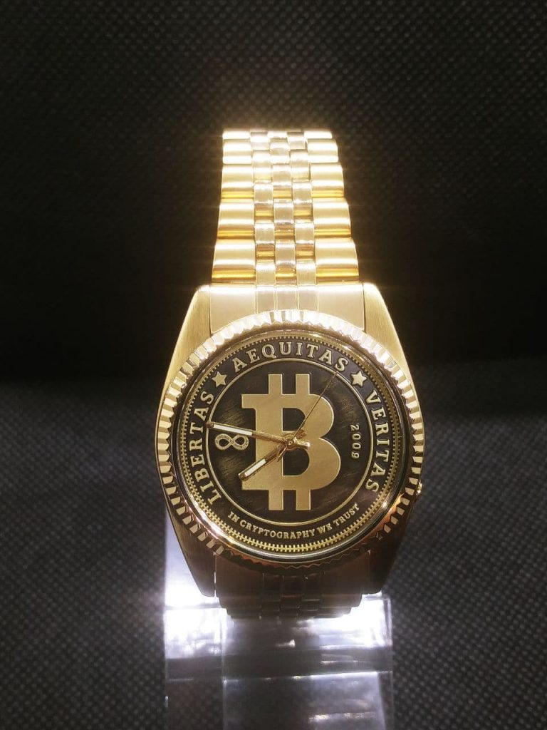 Seiko Mods by Wellingtime  in the UK. Seiko DateJust Bitcoin Mod: This stunning one off seiko mod takes the gold plated seiko 7S26 3119 and replaces the dial, movement & crytsal with a limited edition Bitcoin watch Dial (1of100), a Seiko NH36 movement and a sapphire crystal. This is one for the bictoin boys and girls. The original Seiko Watch is  a hommage to the Rolex DateJust - this includes the fluted bezel and gold Plated Jubilee strap.  This Mod could be done to a Rolex too if bitcoin bought your Rolex!