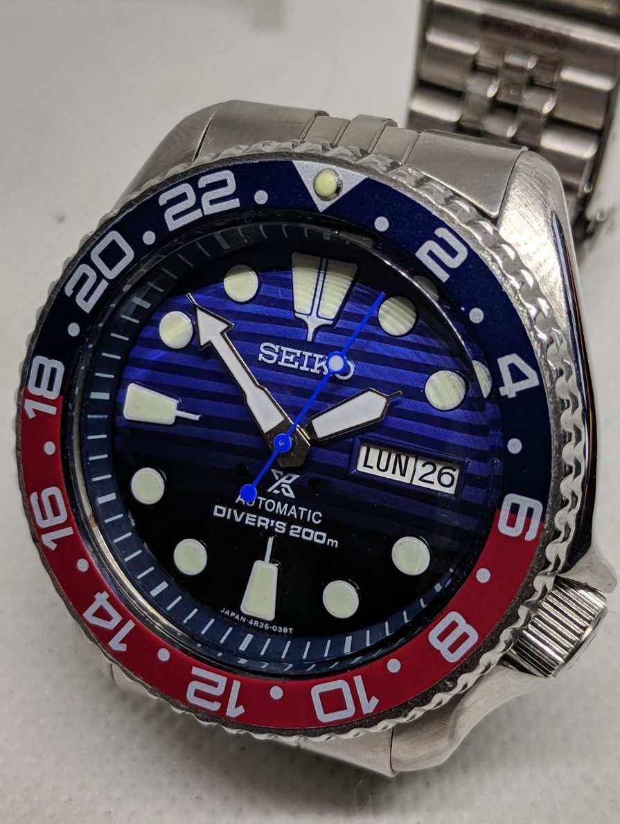Seiko Mod by WellingTime UK. Seiko SKX009  Prospex Mod: Save the Oceans Dial with black to blue faded colour and bright lume, pepsi (Blue & Red)GMT bezel  insert. Original Seiko SKX hands with a blue counter-balance second hand and a Seiko Jubilee Bracelet