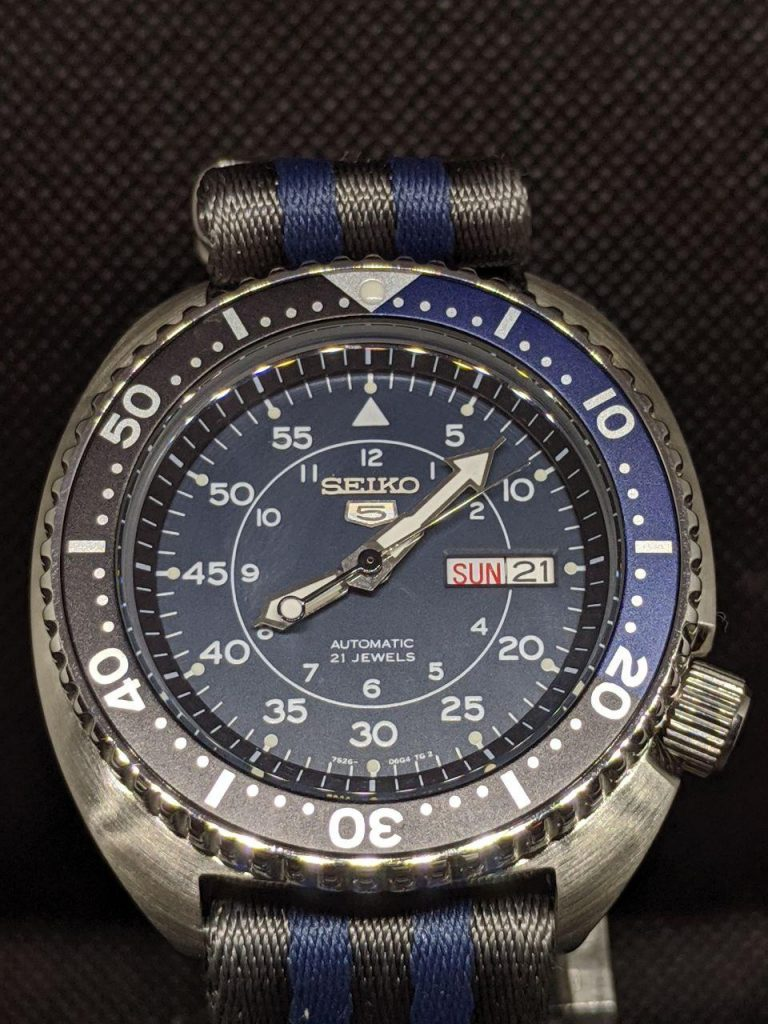 Seiko Mod by WellingTime UK.  Seiko Turtle - SNK Military Mod: this mod includes SKX Hands, Blue Military Dial taken from a Seiko SNK, The bezel insertis in blue and dark grey matching the dial. Completed with a matching strap. This one is a beauty!