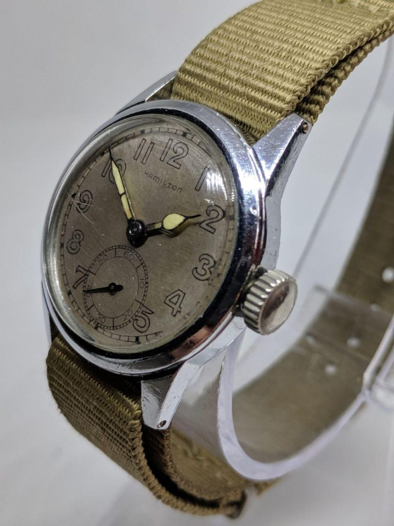 Watch Repairs in the UK by WellingTime. A swiss Hamilton 1940's Tea Cup with sub second dial. The case is stainless steel approx 32mm with an oversized crown which was probably chome at some point. This is an extremely rare vintage watch refurbished by Wellingtime. The watch is fitted with a 16mm canvas NATO strap.