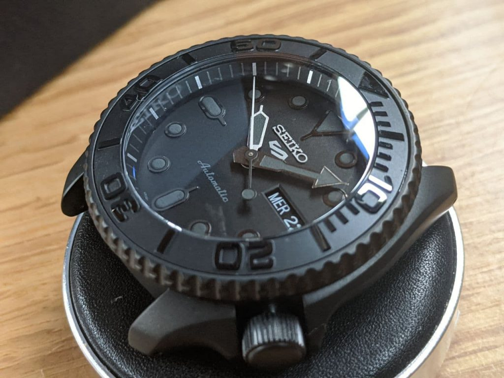 Seiko Mod by Welingtime UK. Seiko SRPD79 Mod - Stealth Yacht Master: A Seiko SRPD with a black case and black bezel . The watch has bee modified to include a double dome sapphire crystal with a blue AR coating and a black Yacht Master bezel insert.