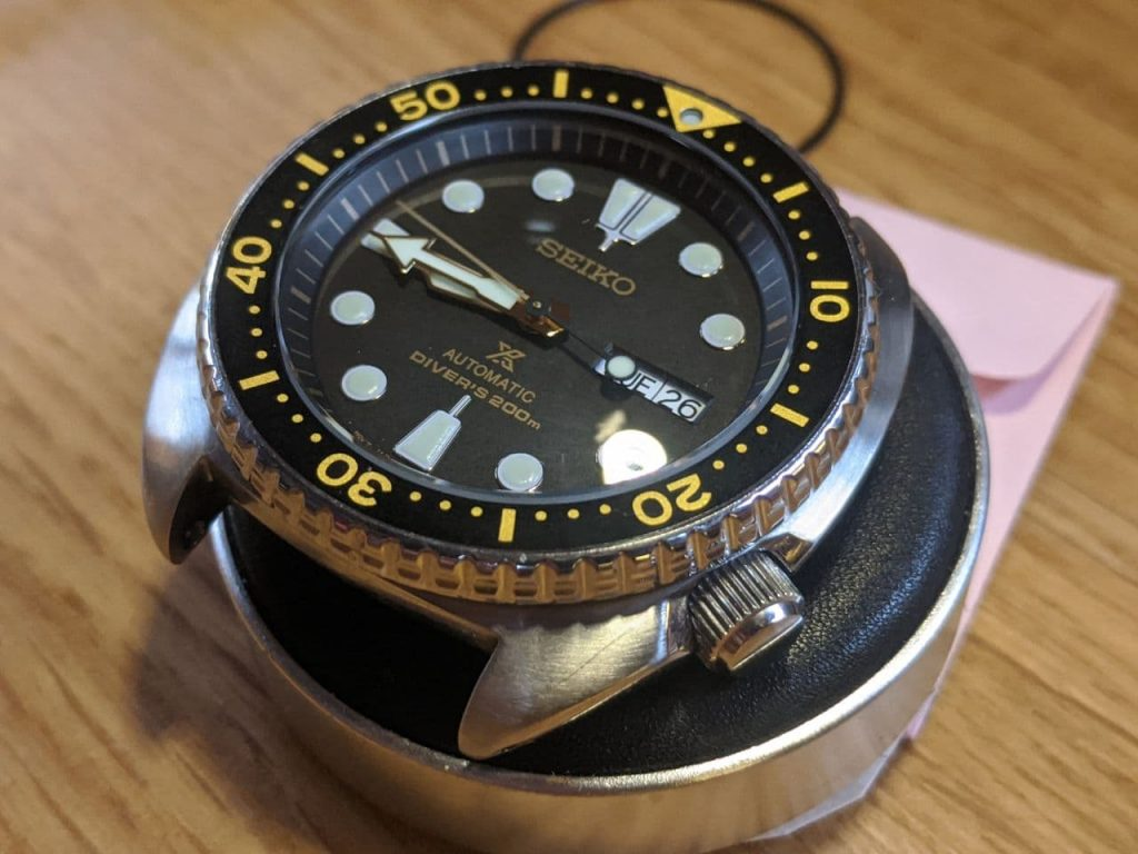 Seiko Mod by Wellingtime UK. Seiko Turtle (SRP) lightly modified with a raise dome sapphire crystal with a clear AR coating. The watch has retained the original black and gold bezel insert. The gaskets were changed during the mod as the owner had purchased this second hand