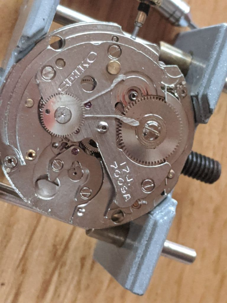 Wellingtime UK watch repair of a Vintage Seiko 7009 DateJust Balance and ratchet removed for watch repair, there is a fair amount of excess grease all obver this watch. Thankfully its here for a professional wellingtime watch repair!