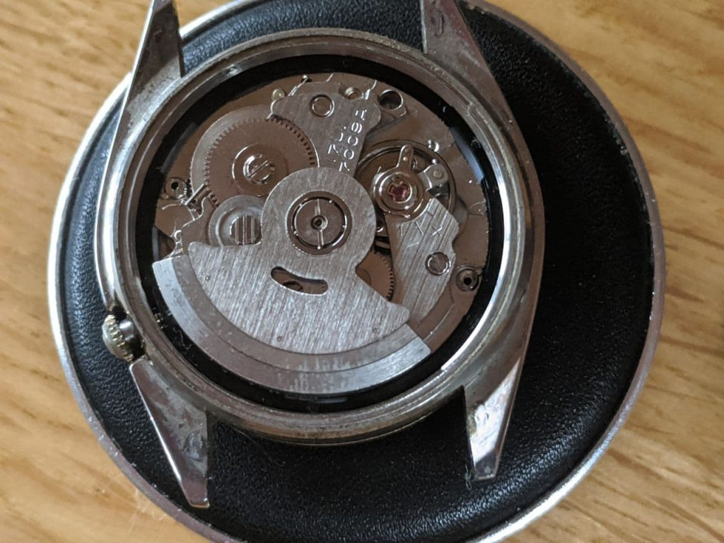 Wellingtime UK Watch Repair - The case back has been removed so the watch movement can be removed for repair. The movement is stainless steel in a stainless steel case. DateJust Watch repair