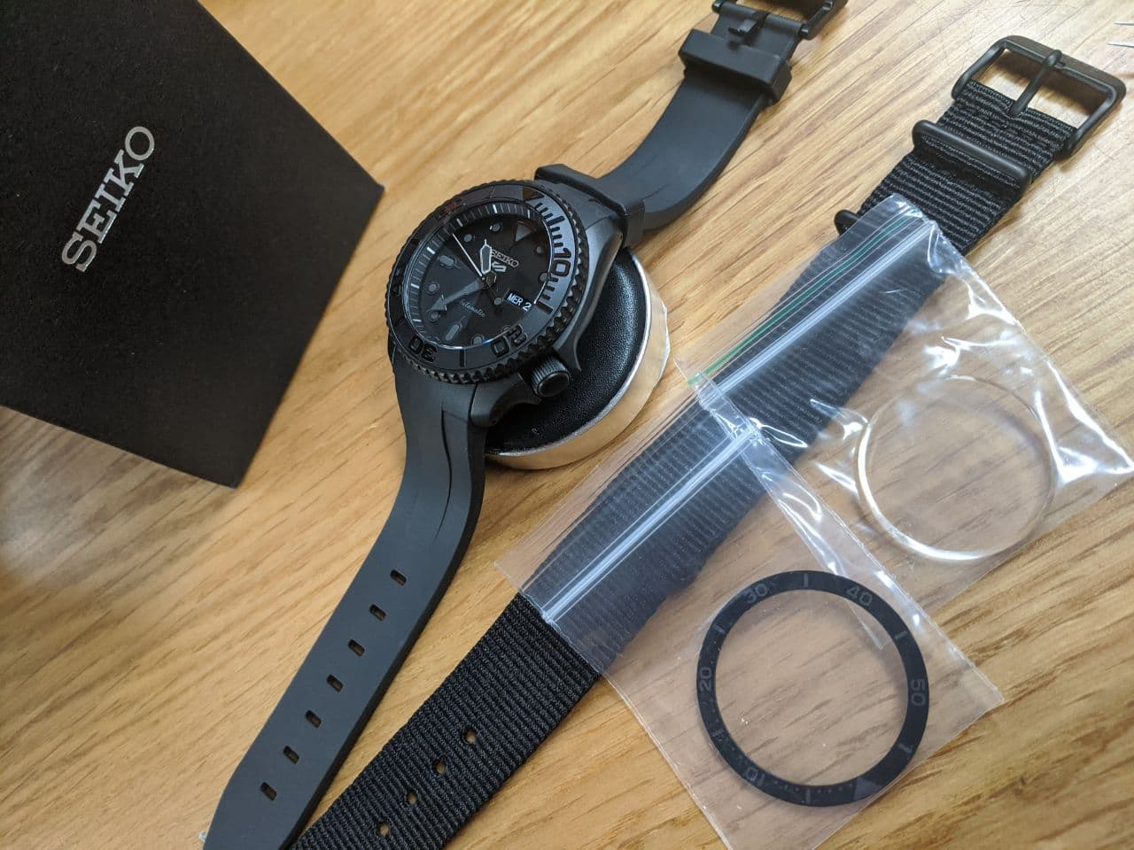 Seiko mods in the UK - SRPD79 Black Stealth Yacht Master mod. This mod includes a double dome sapphire crystal with blue anti reflective coating a Yacht Master bezel insert and a Rubber Oyster Bracelet 2 peice