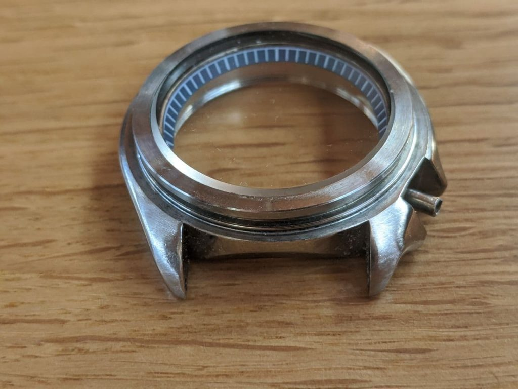 Seiko 6309 - crystal assembly - final the crystal retaining ring to be pressed  onto a vintage seiko 6309. 3 of 3