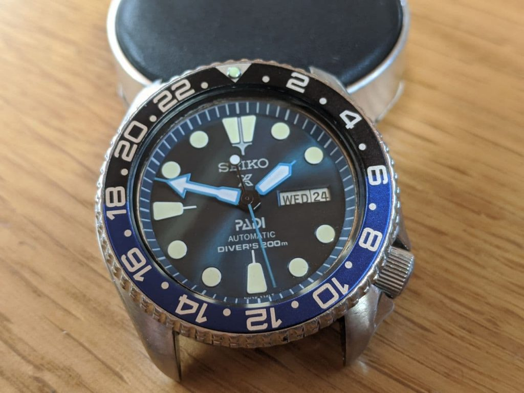 Seiko 6309 mod complete -Vintage Batman Mod -  Blue hands -  blue chapter ring and dial -  Vintage Seiko Watch Mods displayed on watchmakers cushion
