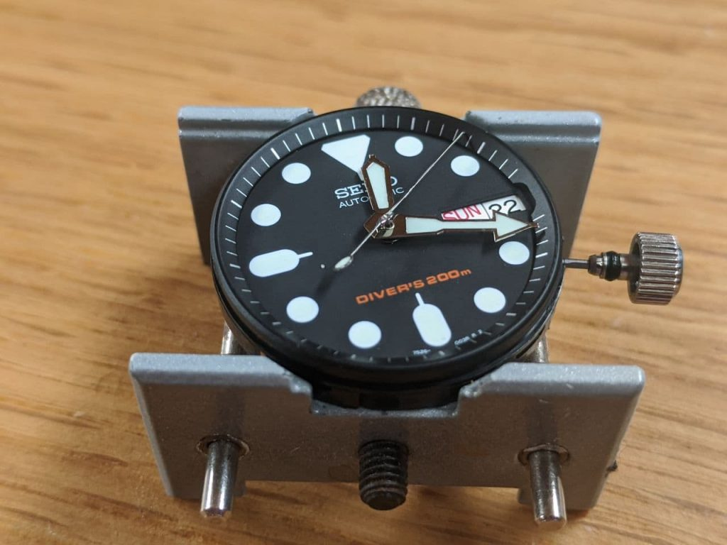 Seiko SKX013 Mod - oversized hands - hour and modified minute hand fitted. Second hand on pinion before length removed from end to fit inside the chapter ring.